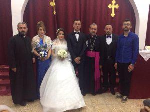 مشاركة الخور اسقف فيليبوس في مباركة العرسان في كنيسة مريم العذراء في قرية باگيرات